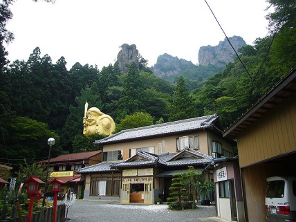 Golden Daikokuten and mountain view